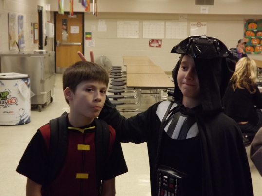 Zack and his best friend on and off-ice ham it up at school trick-or-treat