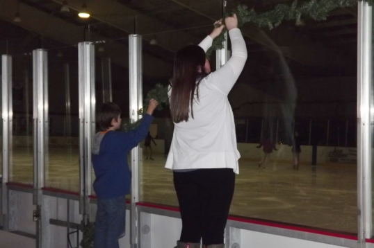 Last year, Zack helped hang Christmas decorations at the skaing rink
